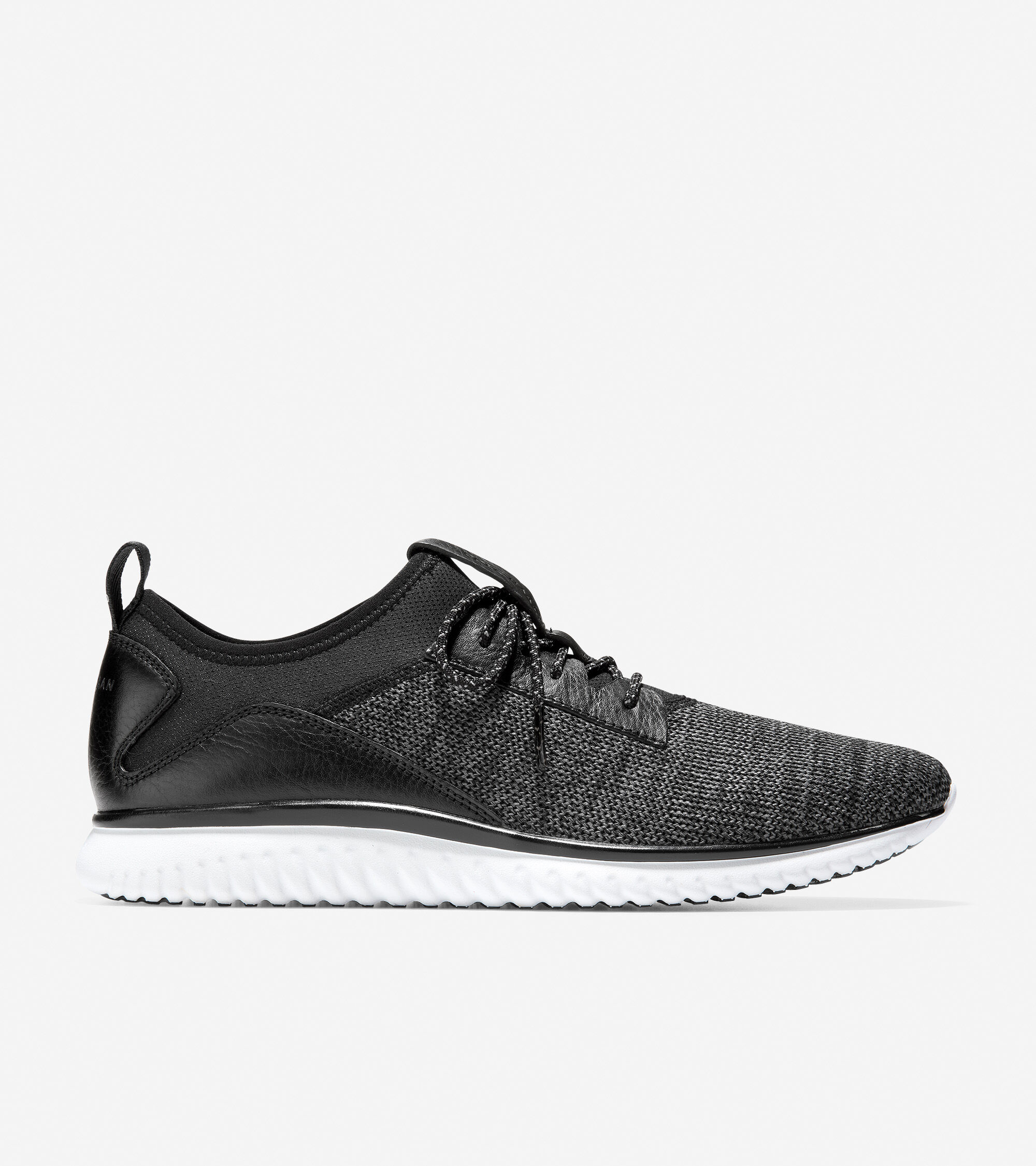 Knit uppers with leather detailing. Cushioned Grand 360 footbed lined in moisture-wicking textile for breathability. EVA Midsole with a rubber outsole for traction and comfort.