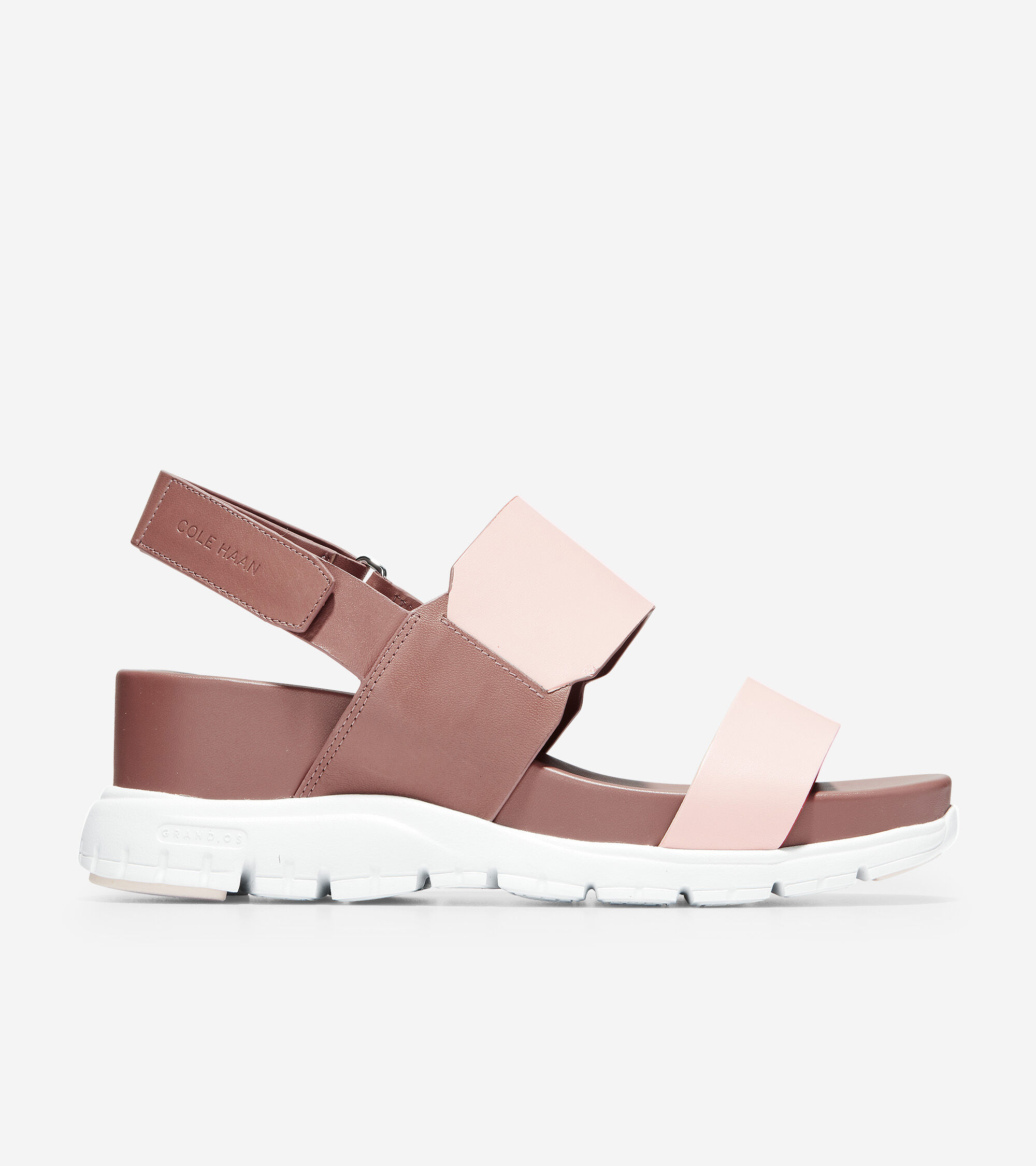 Leather upper with Velcro ankle strap for easy closure. Fully lined. Cushioned footbed. Rubber outsole plugs with Grand.ØS technology for ultimate comfort.