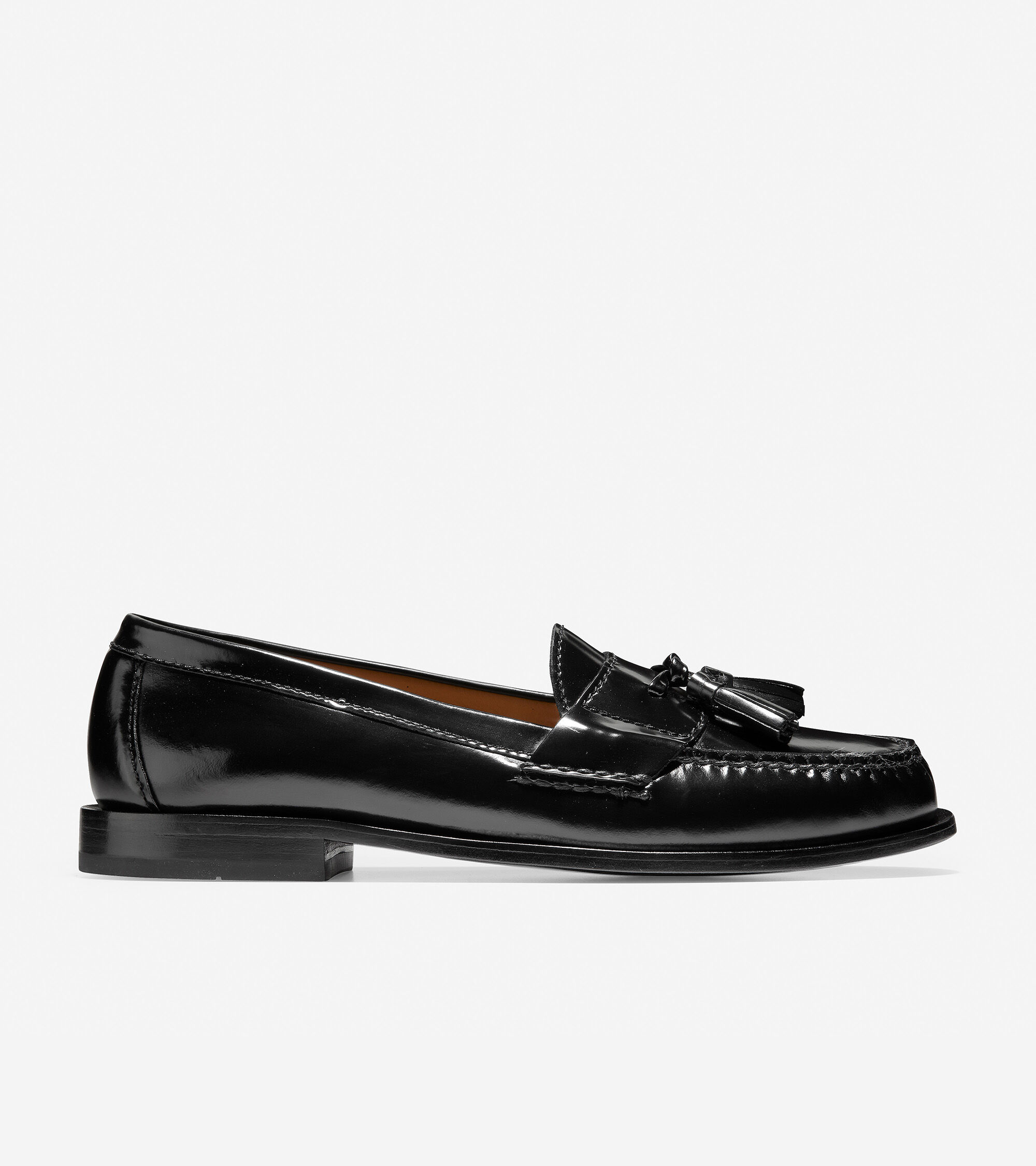 Hand-antiqued, brush-off leather upper. Genuine hand sewn on the last moccasin construction. Fully leather lined. Leather sole with combination stacked leather heel.